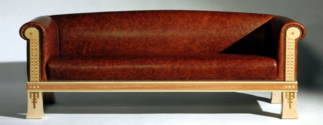 Custom sofa in premium hide on a Maple frame inlaid with Tulipwood, Swiss Pear and English Cherry