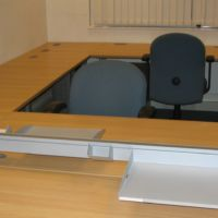 Extra desk space released with third level paper management trays