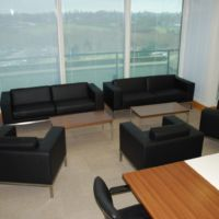 Comfortable seating for informal discussions in corporate boardroom