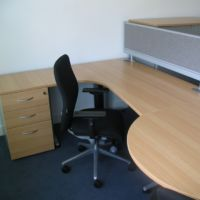 Practical workstation for manager combining privacy with space for visitors