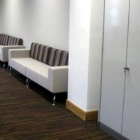 Modular soft seating with full height cupboards